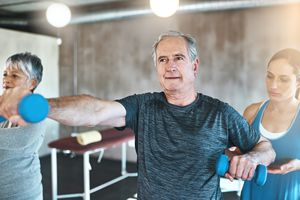 Man using dumbbells in a fitness class