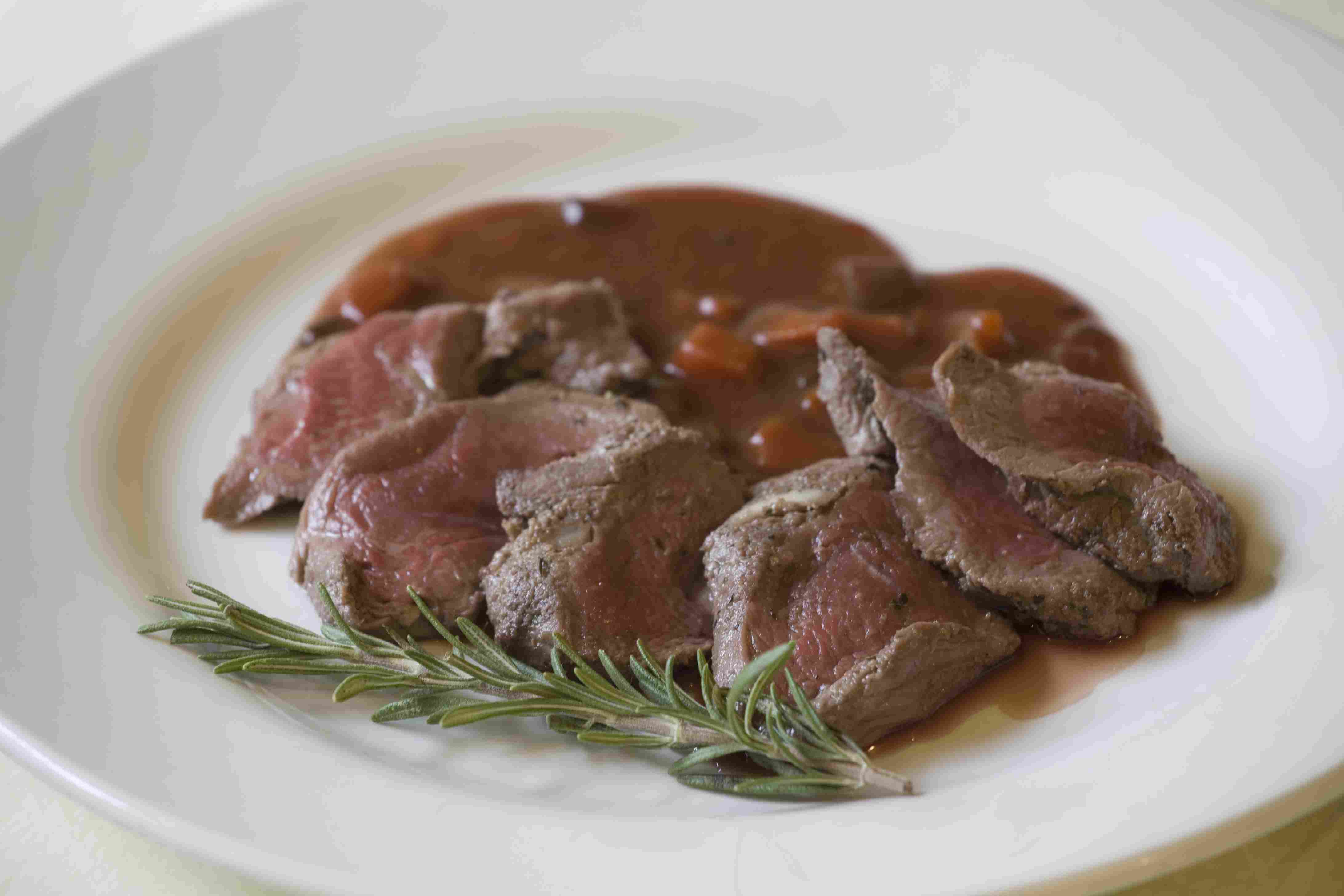 Venison with a spring of rosemary