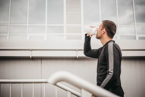 Young athlete man drinking
