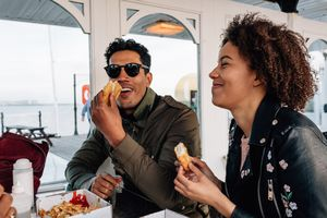 Man and woman eating food together
