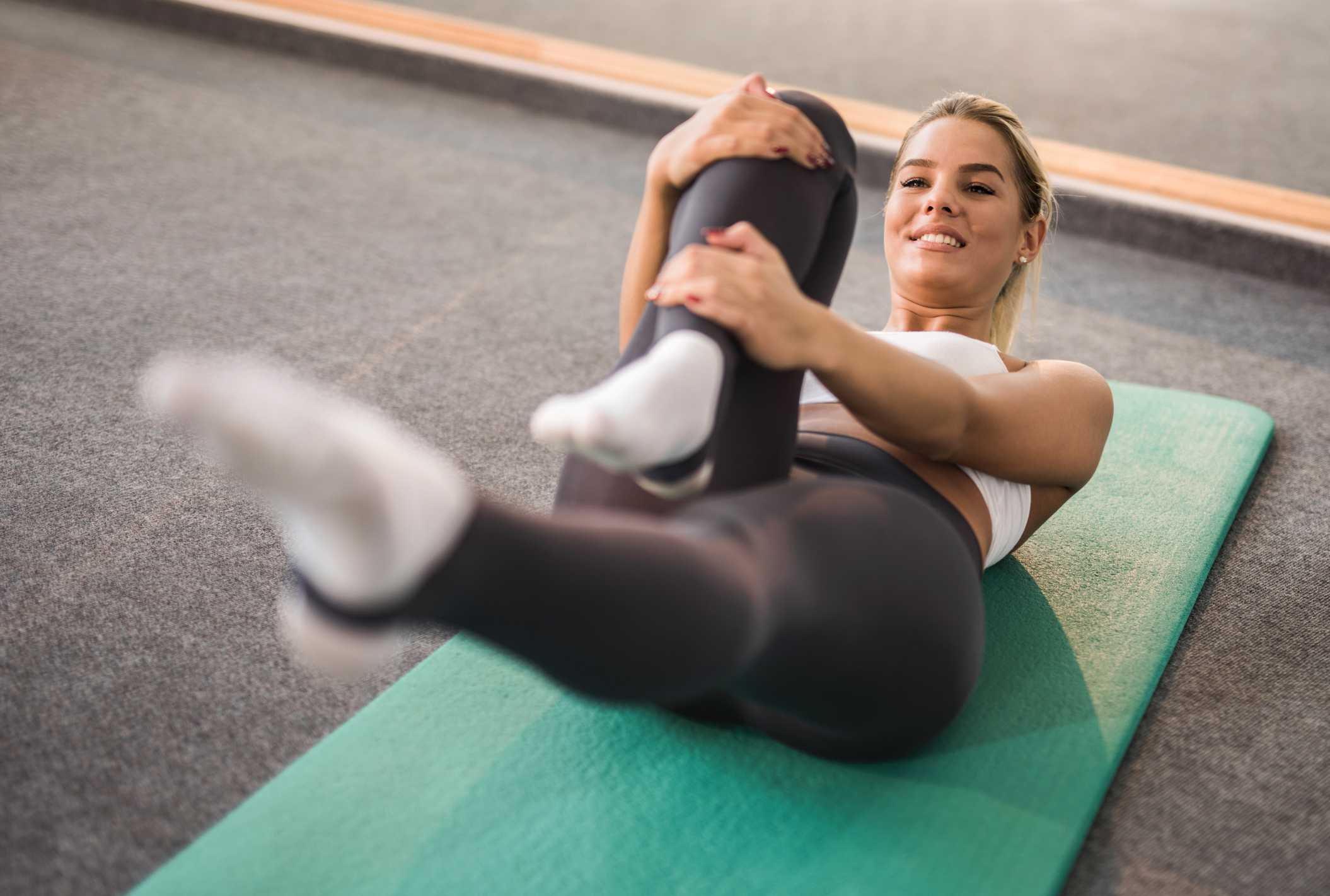 woman doing Pilates on mat