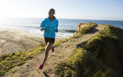 Running a path near the Pacific Ocean.