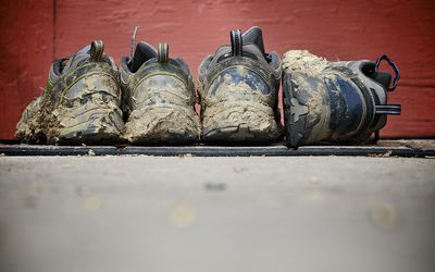 Muddy trail running shoes.