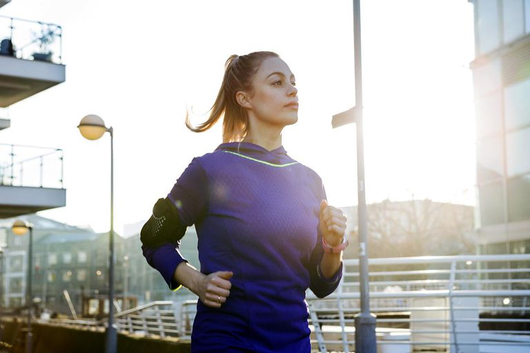 Female runner running in urban environment.
