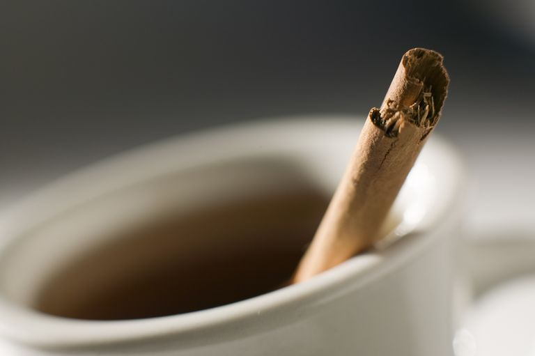 Tea and a cinnamon stick.