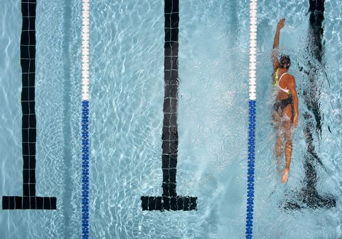 Women swimming laps