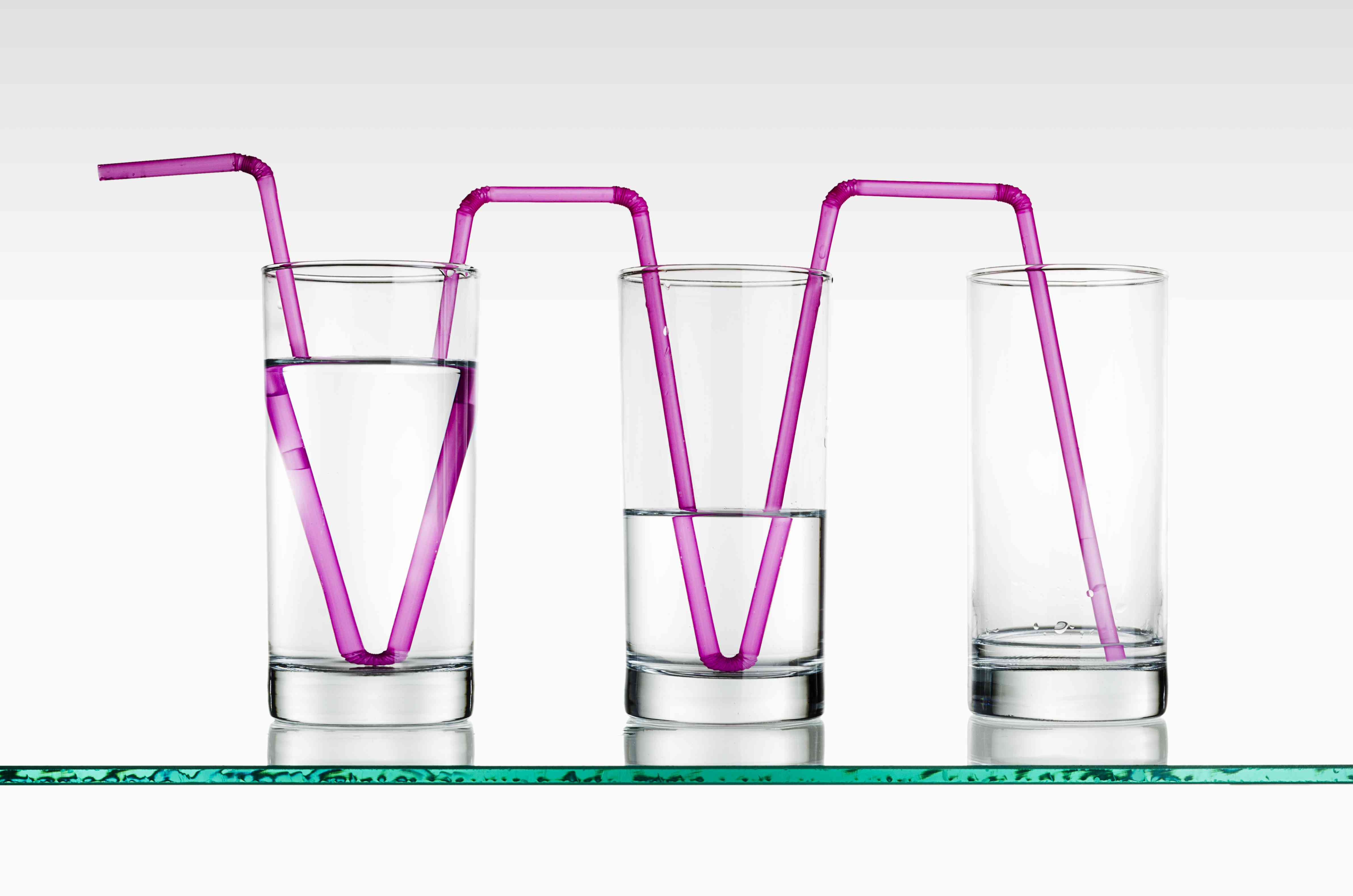 Glasses of water with straws