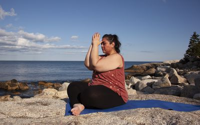 Woman meditating with hands to the third eye