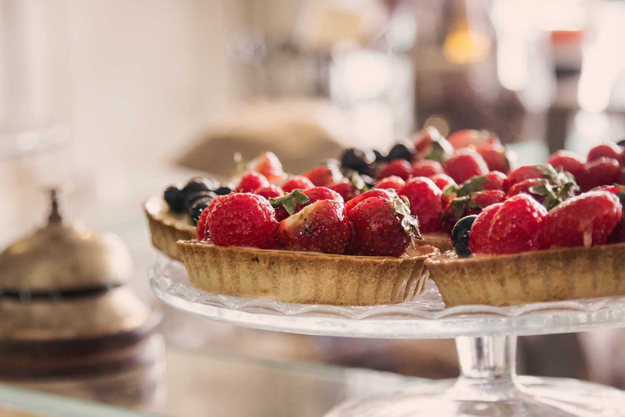 Small fruit tarts on a cake stand