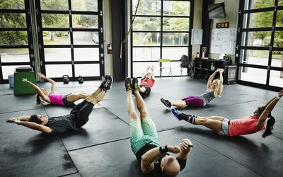 Group of friends doing ab exercises