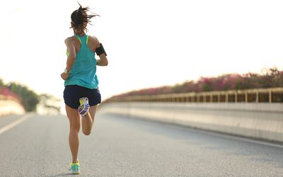 Young woman runner training for a half-marathon