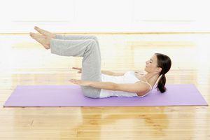 Woman doing pilates on mat