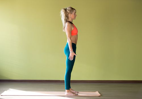 Woman standing on a yoga mat