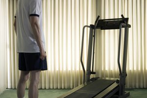 man standing in front of a treadmill in his home