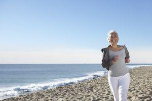 Mature woman jogging on beach