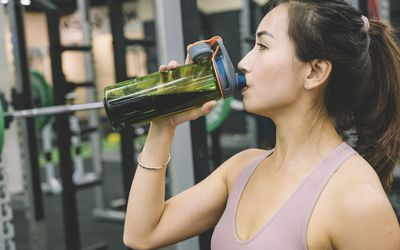 Woman drinking from a BPA-free water bottle