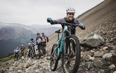 Eager friends mountain biking on craggy trail