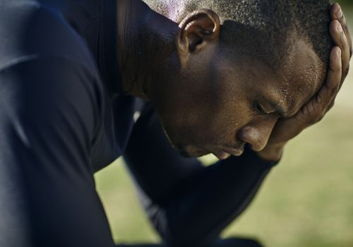 Athlete concentrating with his eyes closed