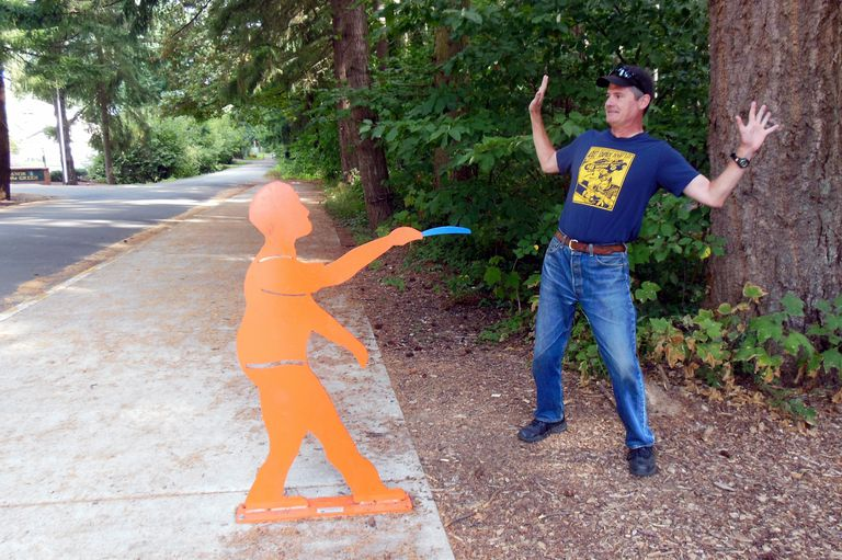 Walker Threatened by Disc Golf Statue