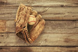 Directly Above Shot Of Baseball Ball And Glove On Table