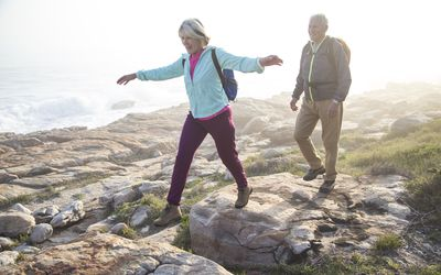 Senior couple walking outdoors together
