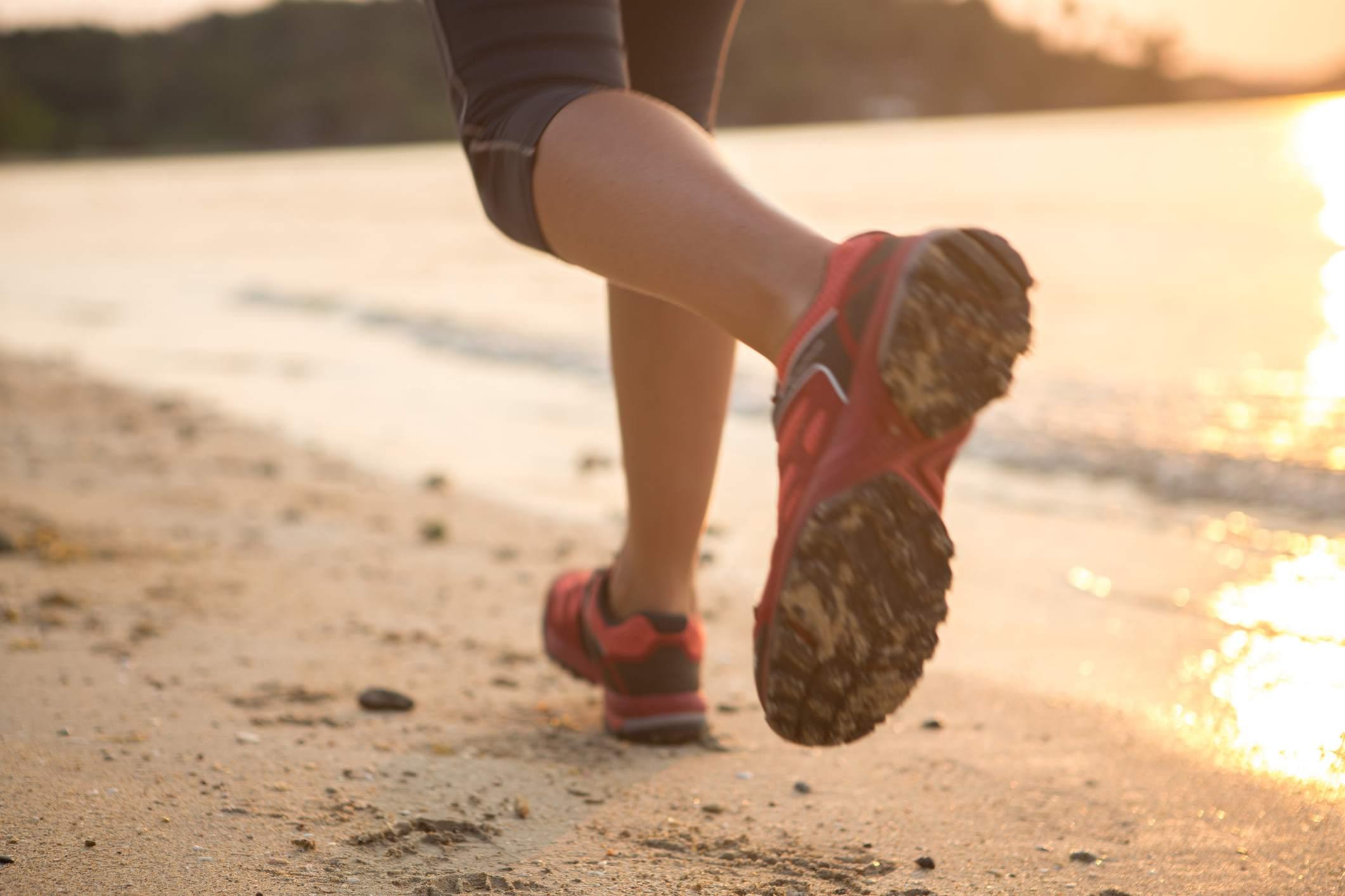 Running on the beach at sunset