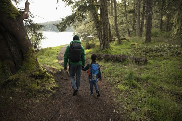dad and kid hiking