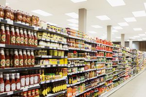 Stocked shelves in grocery store aisle