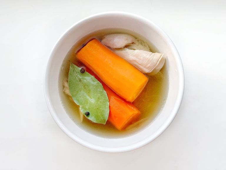 chicken broth with vegetables in bowl