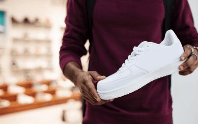 Man holding white sneaker