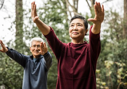people doing tai chi exercises