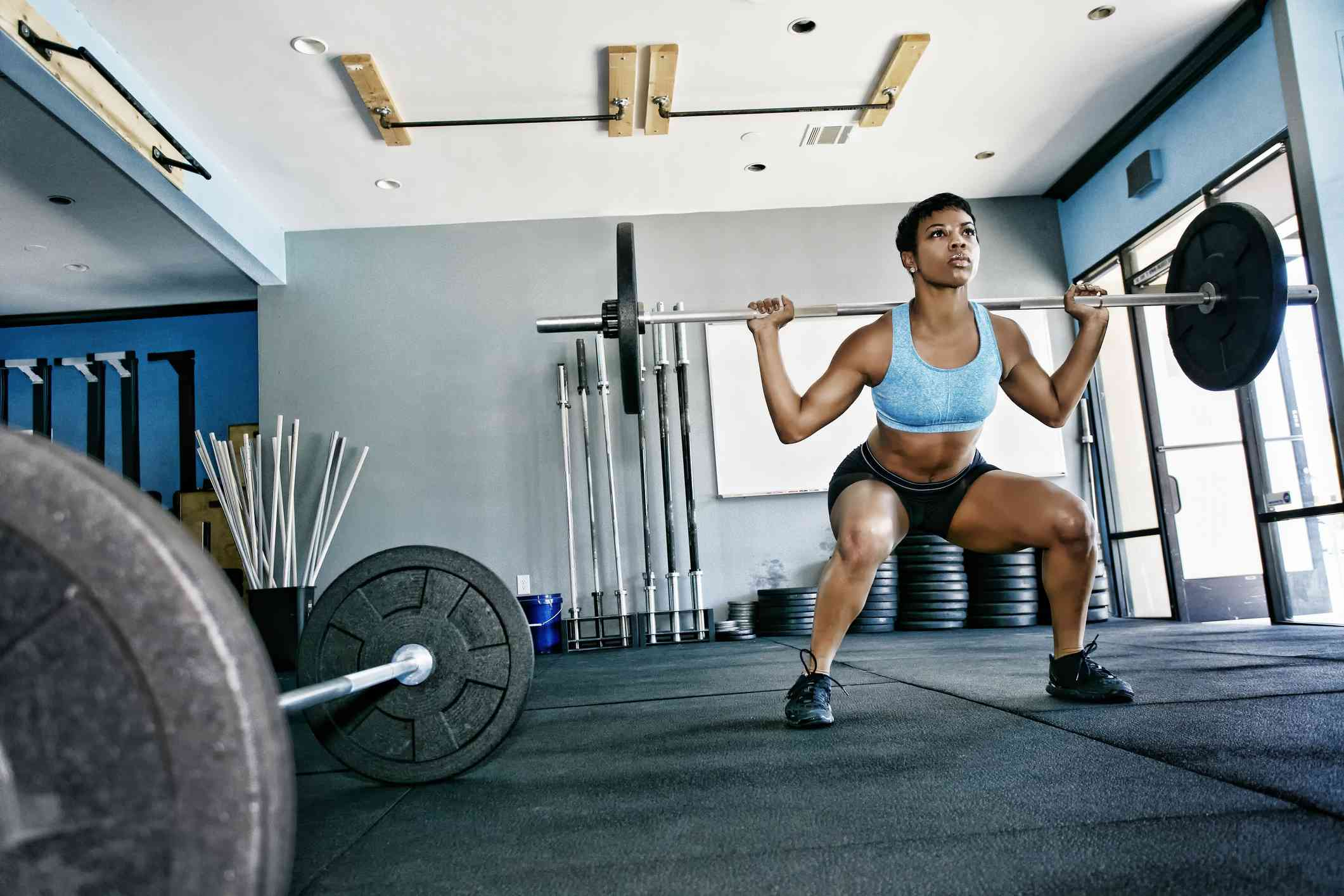Black woman working out in gym