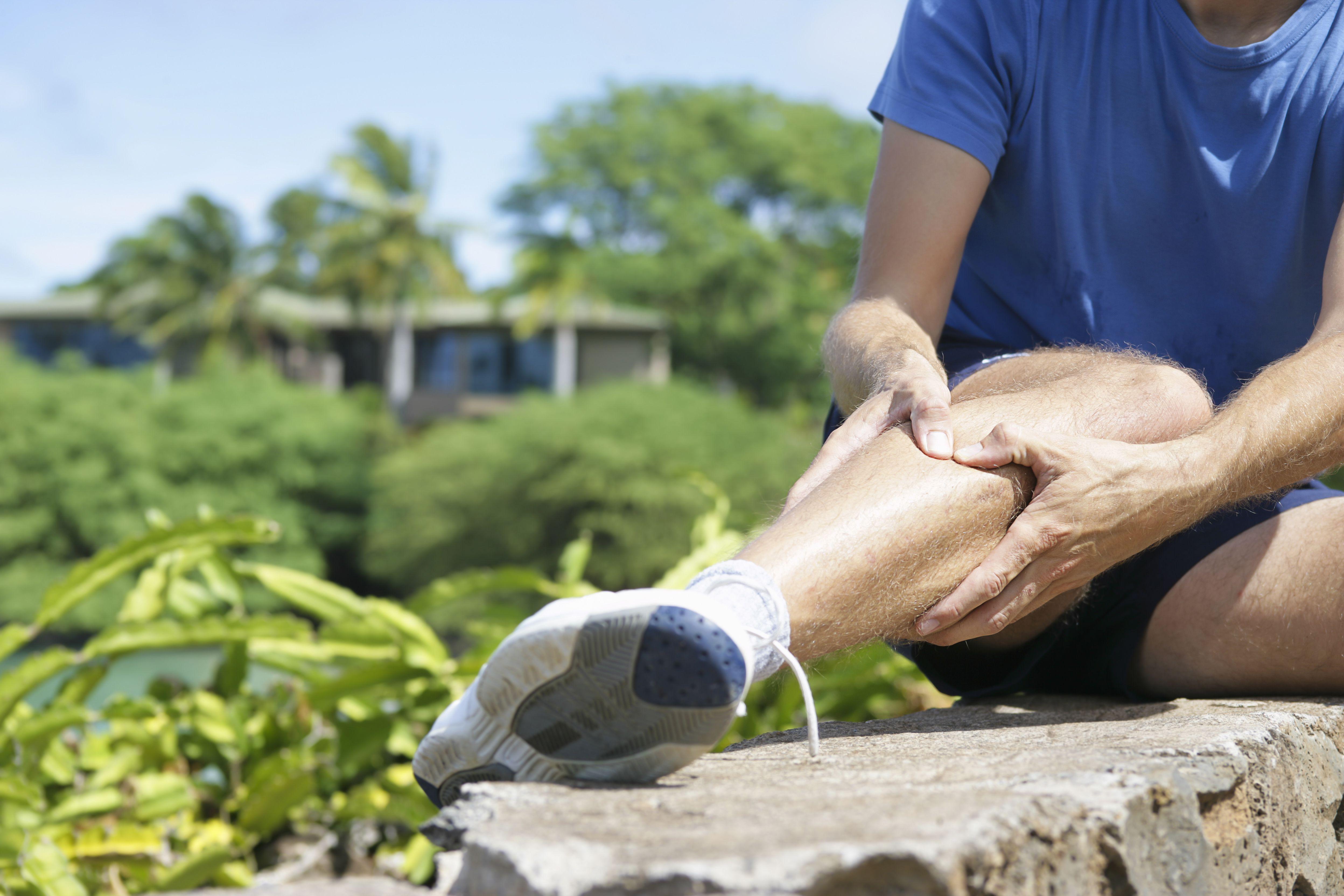 Runner holding leg in pain