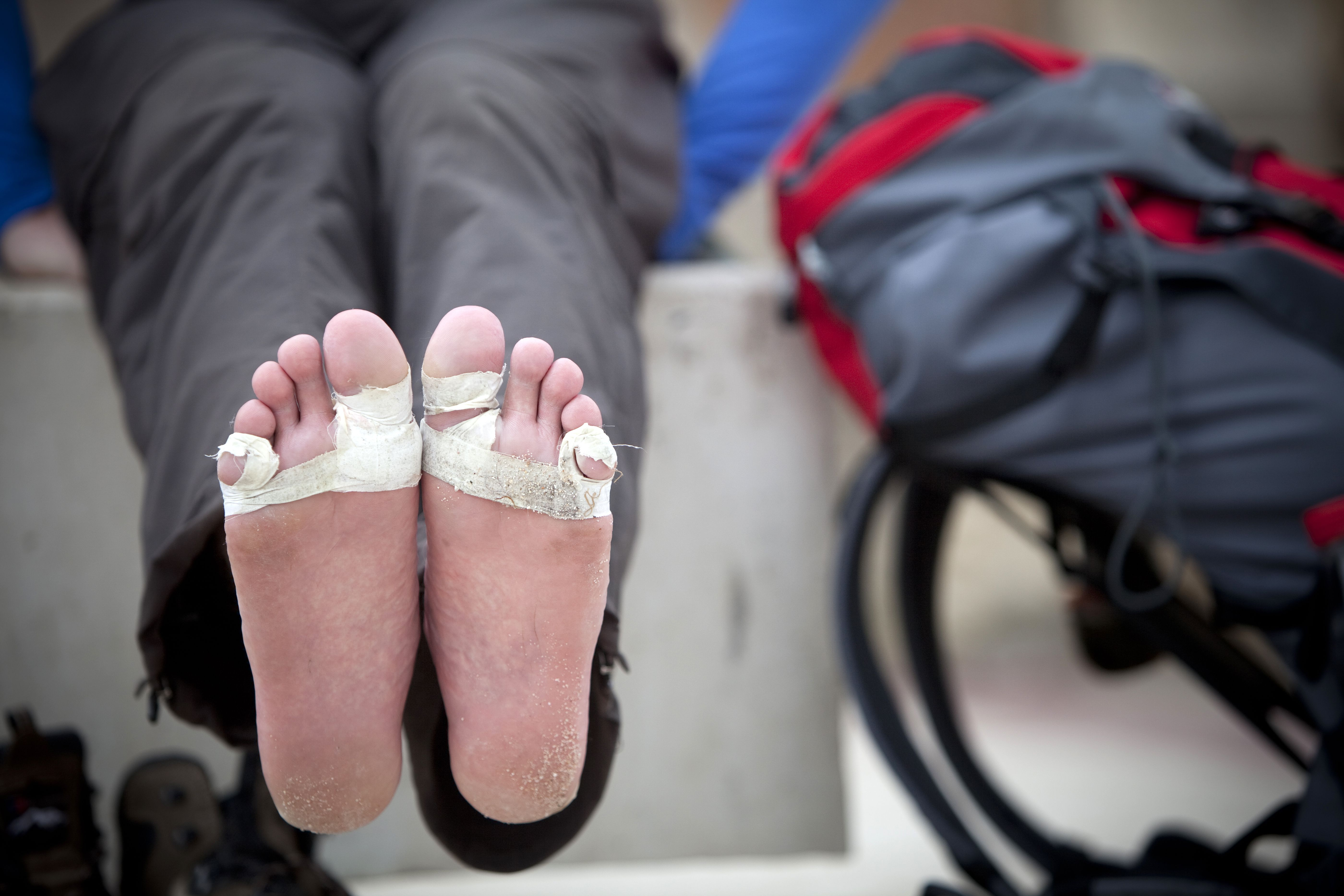 Taped blisters and hotspots on feet of pilgrims on the Camino de Santiago, Spain