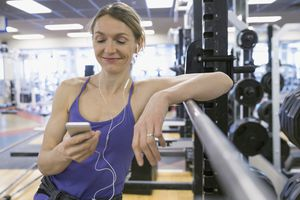 Woman exercising with music