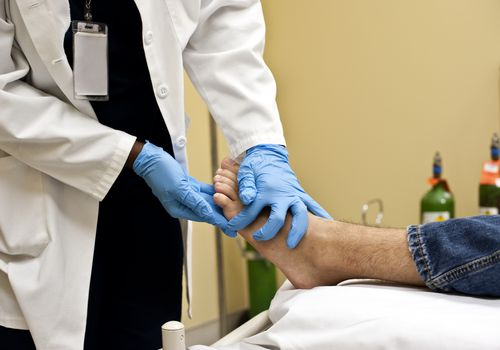 Podiatrist examining patient's foot