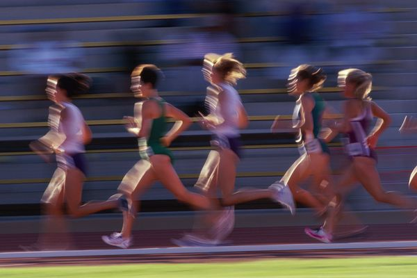 Female runners racing on track (Digital Enhancement)