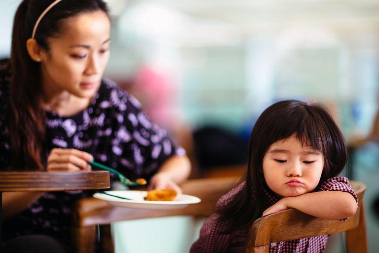 Toddler girl turning head away refuse to eat