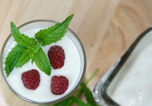 Protein shake topped with raspberries and mint