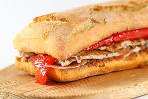 Tasty pork grilled serranito sandwich in a ciabatta