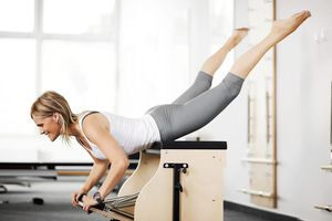 One woman exercising on a Pilates machine.