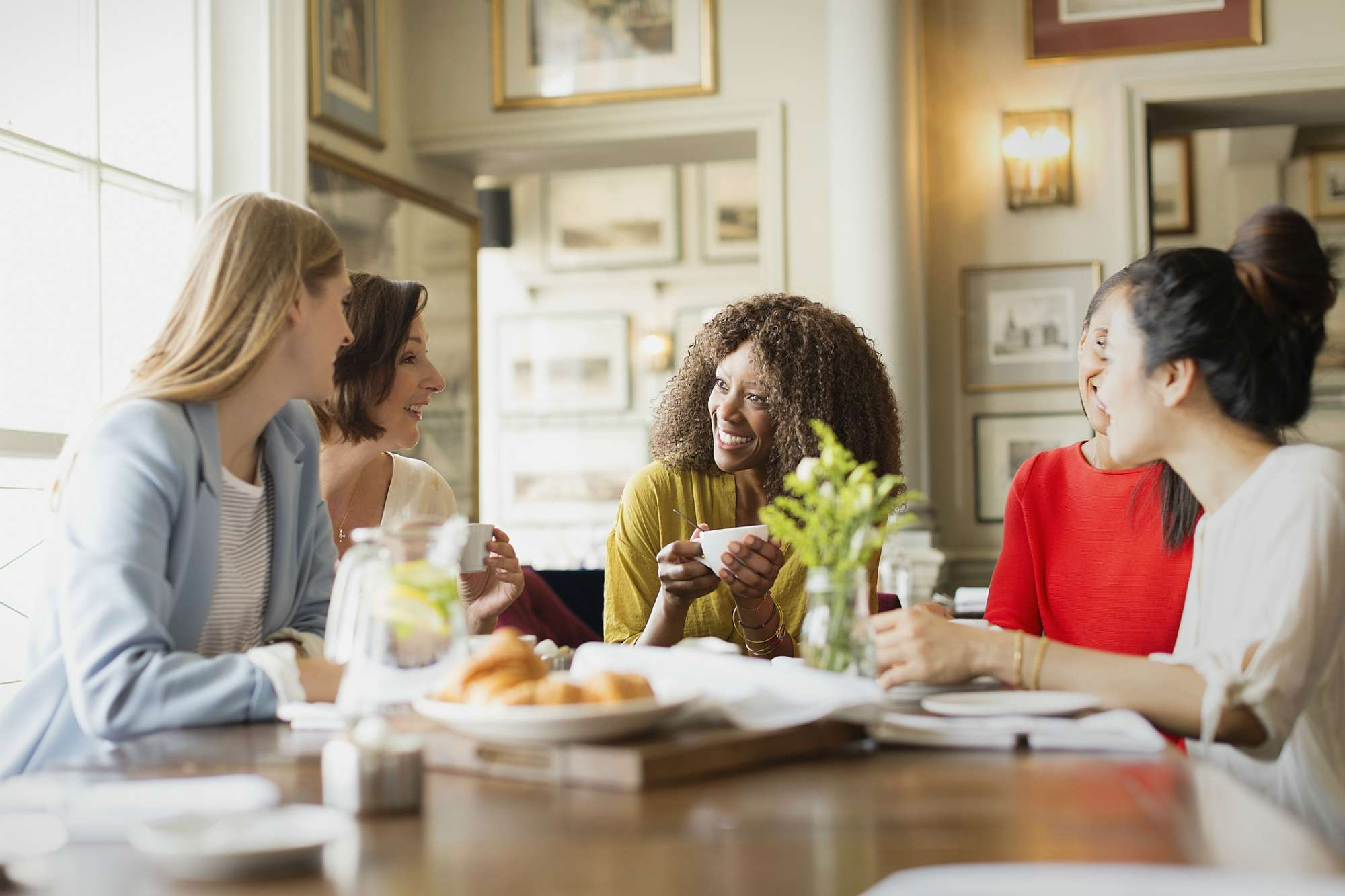 Group of women having coffee and talking