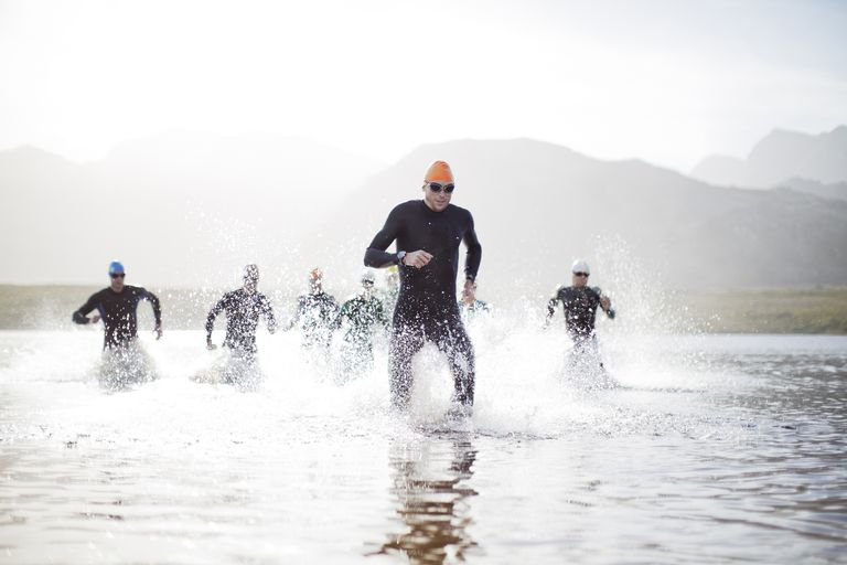 Athletes running out of the water