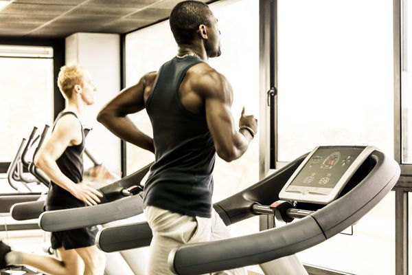 Men running on the gym treadmill