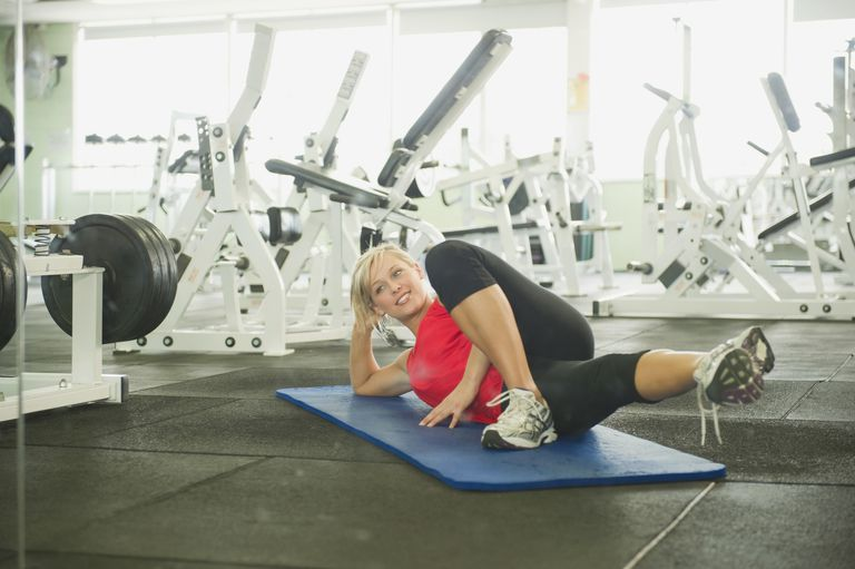 Woman doing inner thigh leg lift
