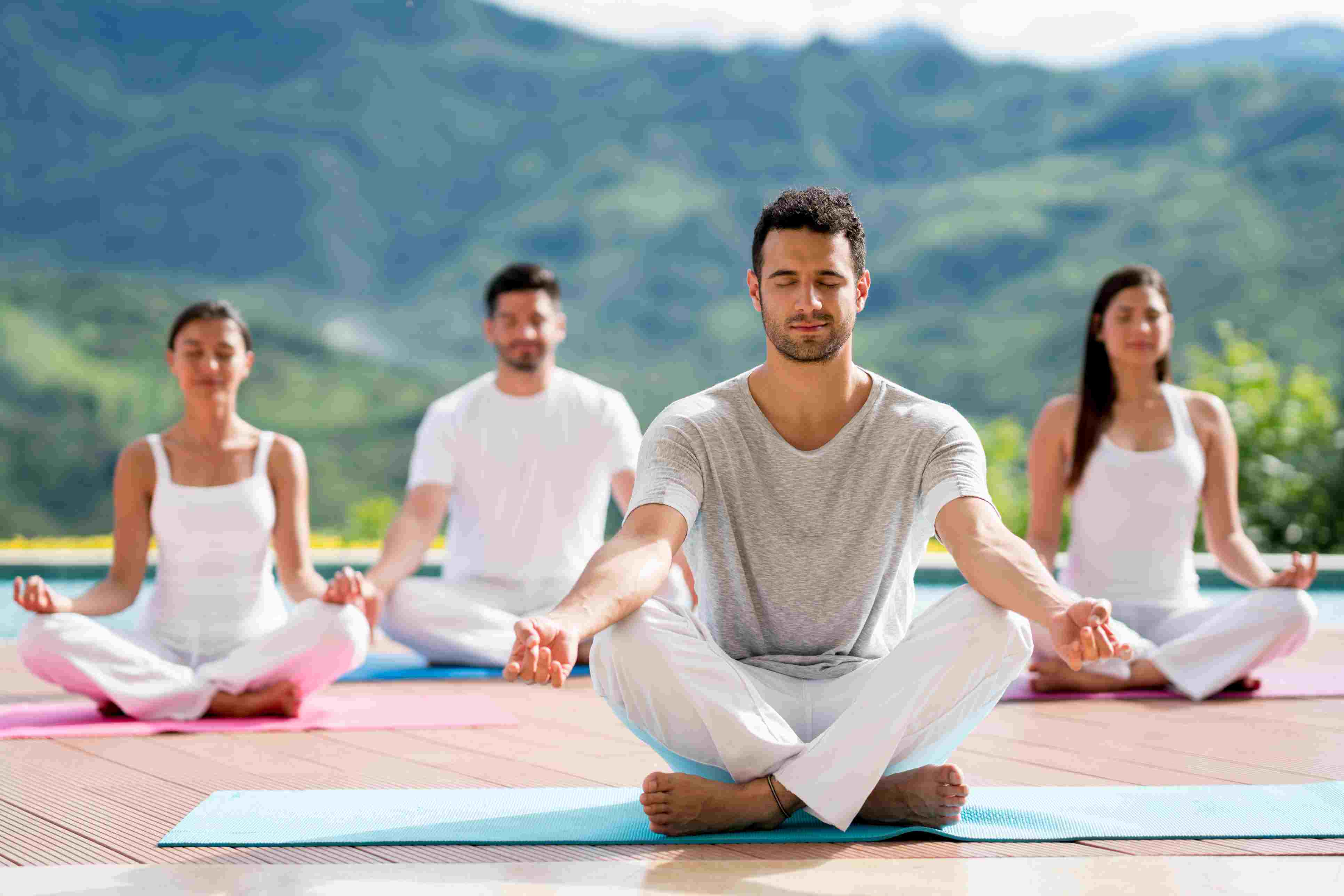 Group of people meditating in a yoga class