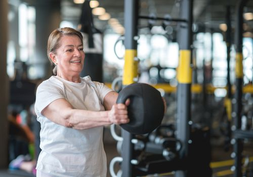 Woman lifting a kettlebell for exercise