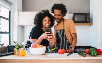 Couple cooking with phone