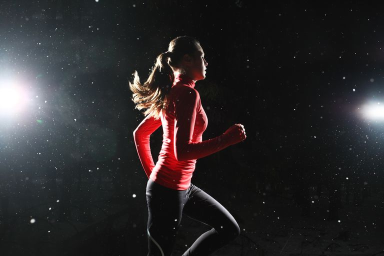 Woman running at night