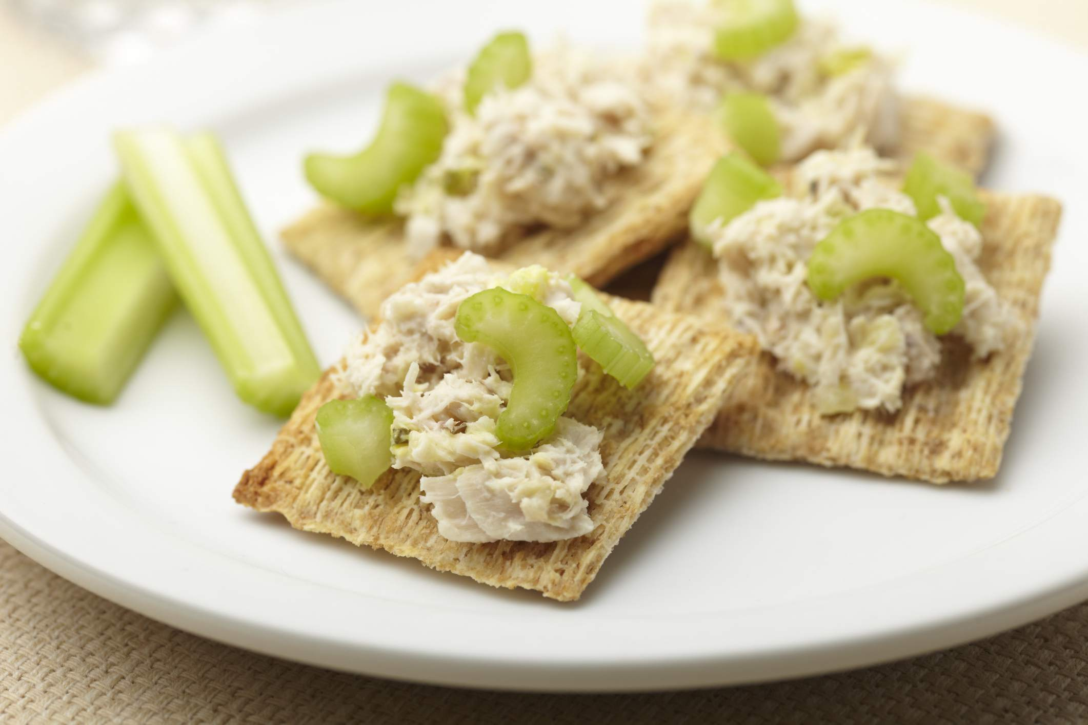 Tuna on crackers makes a healthy snack for work.